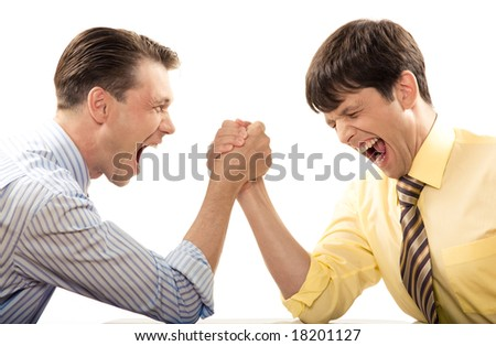 Portrait of emotional men screaming during arm wrestling competition