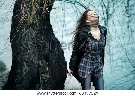 stock photo : Portrait of emotional romantic woman standing on the wind