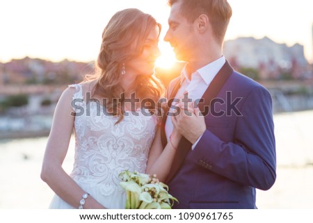 portrait of enamored newlyweds at sunset of the day #1090961765
