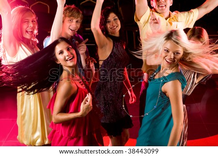 Portrait of energetic people clubbing at discotheque