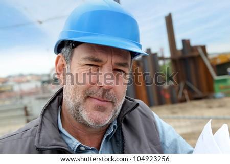 Portrait of entrepreneur on building site