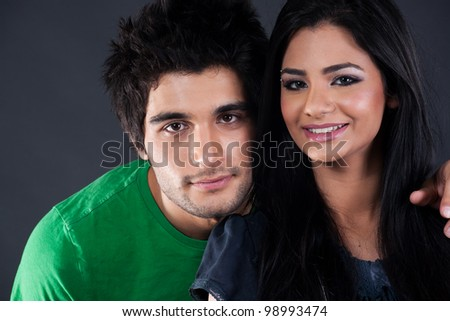 portrait of ethnic couple couple in studio, latin american man with Indian girl