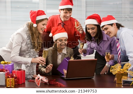 Portrait of excited co-workers gathered together in office and having corporate party