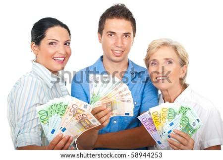 Portrait of excited group of three people holding euro banknotes and smiling isolated on white background