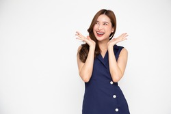 Portrait of excited screaming young asian woman standing in blue dress isolated over white background, Wow and surprised concept
