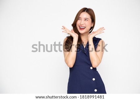 Portrait of excited screaming young asian woman standing in blue dress isolated over white background, Wow and surprised concept Foto stock ©