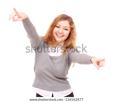 Portrait of excited young woman pointing at you on white background