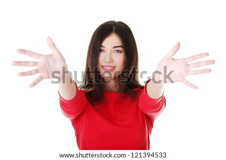 Portrait of excited young woman pointing with both hands towards the camera