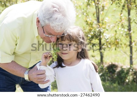 Portrait of family, grandfather enjoying with his granddaughter outdoor