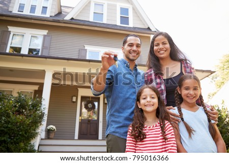Portrait Of Family Holding Keys To New Home On Moving In Day Сток-фото ©