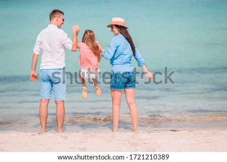 Portrait of family of three on the bech vacation Foto stock ©