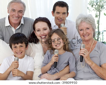 Portrait of family singing with microphones in living-room