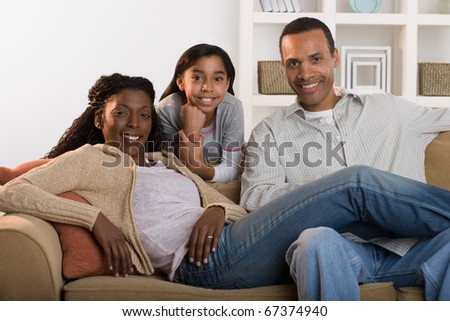 Portrait of family sitting on couch