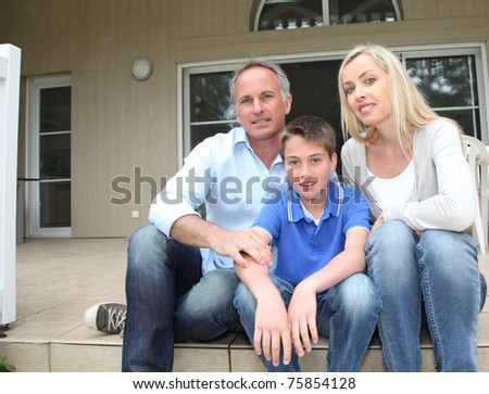 Portrait of family sitting on the front door stairs