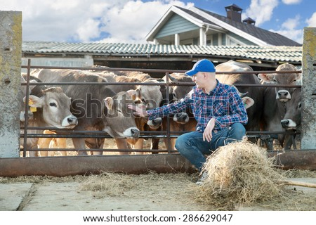 Portrait Of Farmer With Cattle