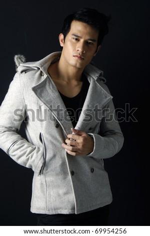portrait of fashion man on black ground