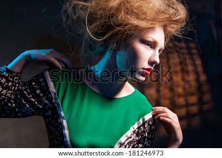 portrait of fashion women in green dress and with red lips abstract dark background