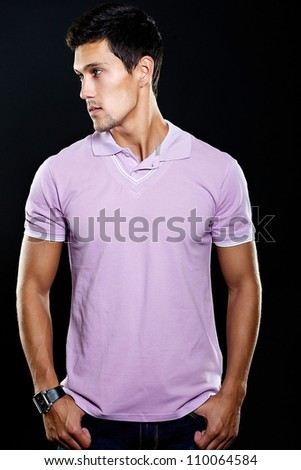 Portrait of fashion young caucasian sexy muscled attractive handsome athletic man boy model in casual clothes isolated on black