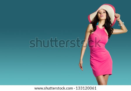 Portrait Of Fashionable Girl With A Hat On His Head Over Blue Background