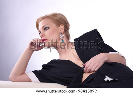 Portrait of fashionable sexy woman lying on the top of sofa