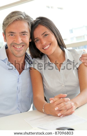Portrait of father and girl in real-estate agency