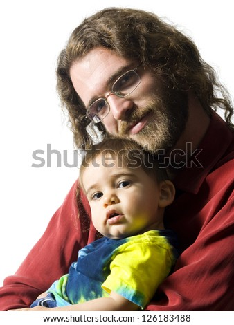 Portrait of father embracing his little son