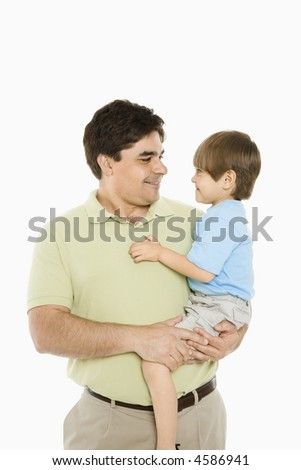 Portrait of father holding son against white background. - stock photo