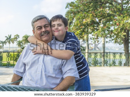 portrait of father with with teenage son