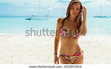 Portrait of female beauty on the beach