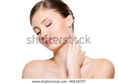 Portrait of  female face  with  a closed eyes stroking her neck over white background