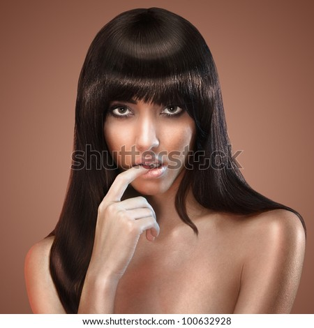 portrait of female face with long beauty glossy dark hair