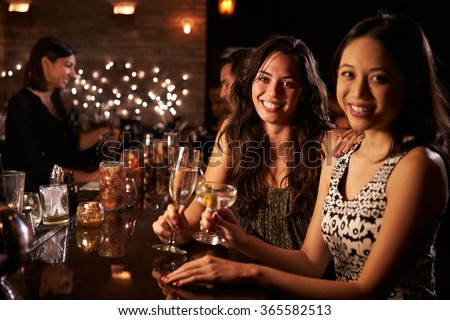 Portrait Of Female Friends On Night Out At Cocktail Bar #365582513