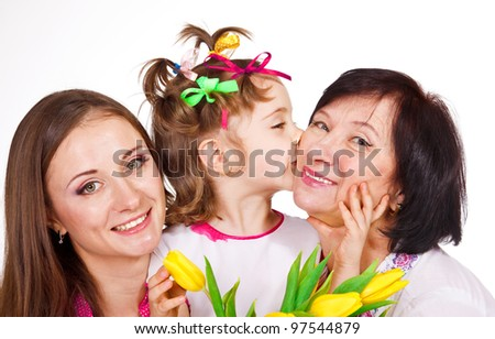Portrait of female generation, granddaughter kissing granny