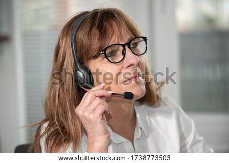 Portrait of female helpline operator in headset Stock photo ©