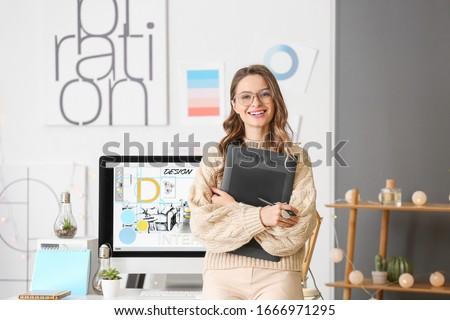 Portrait of female interior designer in office Foto d'archivio ©