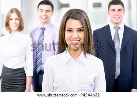 Portrait of female leader with cheerful team