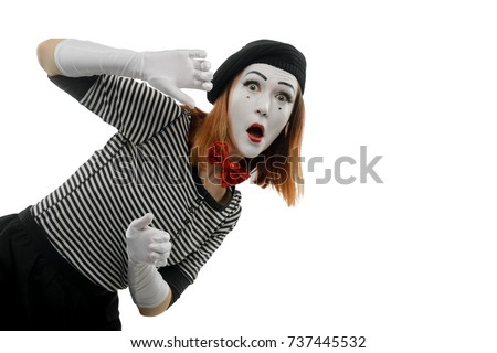 Portrait of female mime artist on white. Woman playing a pantomime performance, showing surprised face and looking out of the imaginary wall.