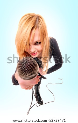 Portrait of female rock singer with microphone in hand  over blue background