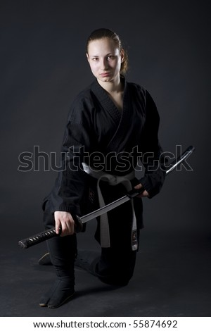 Portrait of female samurai holding katana
