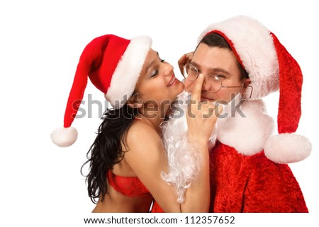 Portrait of female Santa in openwork red lingerie, which  put glasses Santa Claus. Isolated on white.