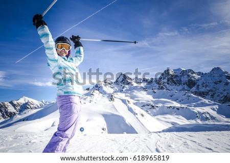 Portrait of female skier at the ski resort #618965819