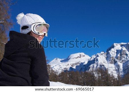 Portrait of female snowboarder wearing goggles