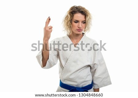 Young Sporty Women Practicing Martial Arts On White