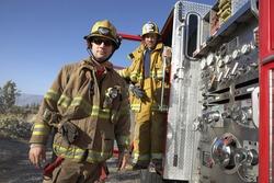 Portrait of firefighters on street