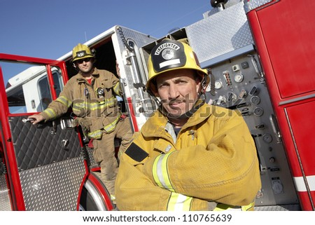 Portrait of firefighters on street