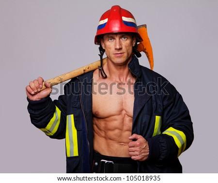 Portrait of fireman on grey background