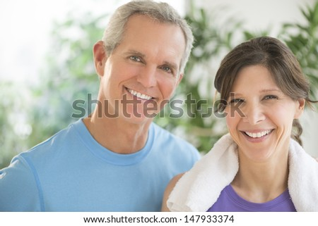 Portrait of fit mature couple smiling outdoors #147933374