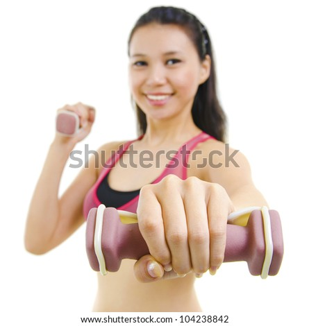 Portrait of fitness woman working out with free weights in studio