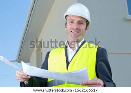 portrait of foreman holding the blueprint