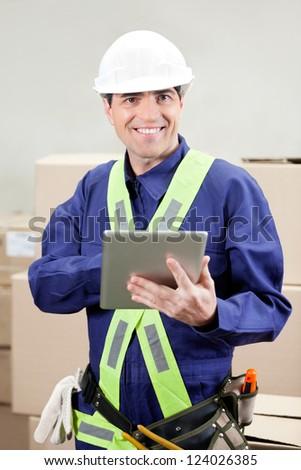 Portrait of foreman using digital tablet at warehouse